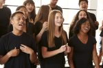 Male And Female Students Singing In Choir At Performing Arts School